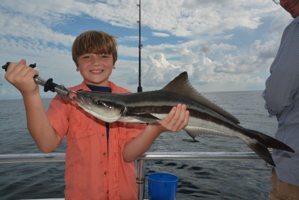 boy-catching-ling-fish-orange-beach