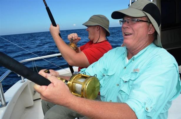 catching-fish-while-trolling-fishing-in-orange-beach