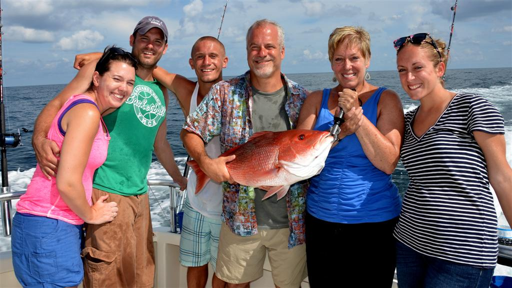 family relaxing while fishing in orange beach