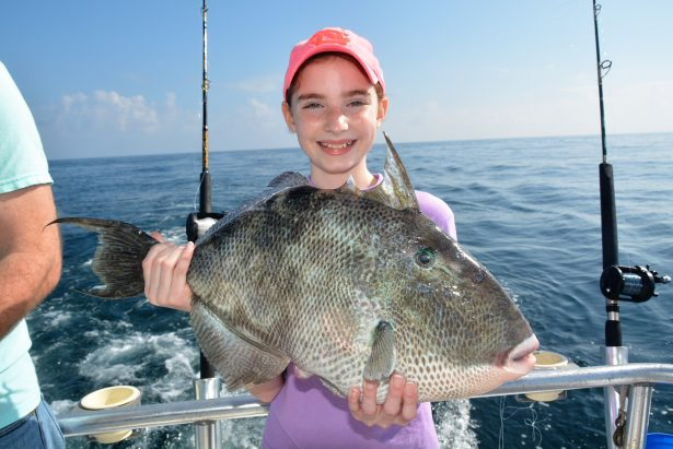 girl-holding-triggerfish