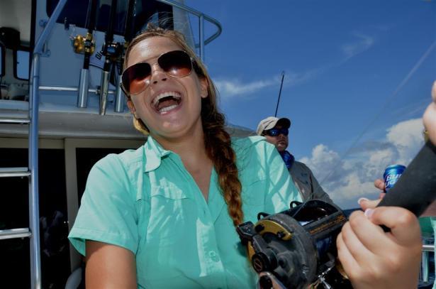 girl-laughing-while-fishing