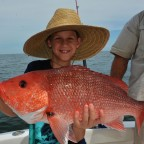 child-holding-red-snapper-fish