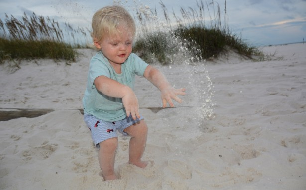 photograph-kid-throwing-sand-on-the-beach
