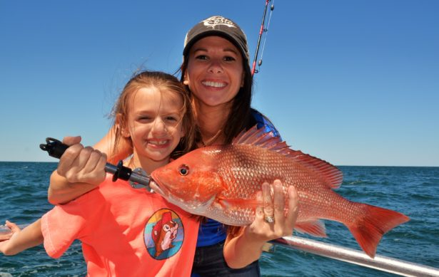 mom-daughter-holding-red-snapper
