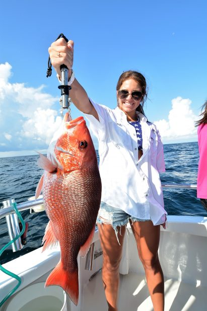girl-catching-big-red-snapper