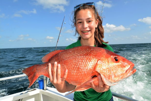 girl-holding-red-snapper-fish